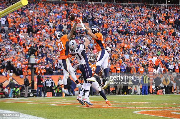 Aqib Talib of the Denver Broncos and Josh Bush of the Denver Broncos and Shiloh Keo of the Denver Broncos defend a throw to Rob Gronkowski of the New...