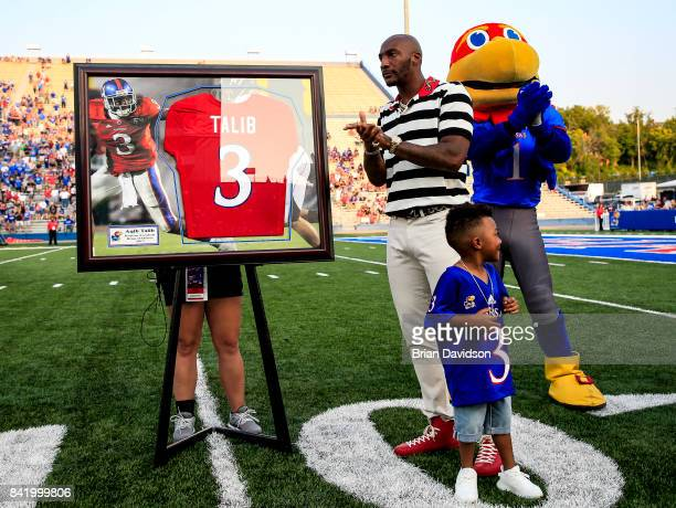 Aqib Talib of the Denver Broncos and Kansas Jayhawks alum is inducted into the Kansas Jayhawks hall of fame during the game between the Kansas...