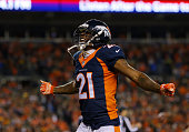Aqib Talib of the Denver Broncos celebrates the Broncos' safety in the fourth quarter against the Green Bay Packers at Sports Authority Field at Mile...