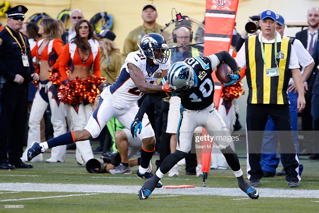 Aqib Talib #21 of the Denver Broncos tackles Corey Brown #10 of the Carolina Panthers by his facemask during Super Bowl 50 at Levi's Stadium on February 7, 2016 in Santa Clara, California. Talib was flagged on the play.