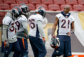 Aqib Talib of the Denver Broncos talks with other members of the Broncos defense during the Broncos practice for Super Bowl 50 at Stanford University...