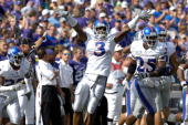 Aqib Talib of the Kansas Jayhawks celebrates with teammates after intercepting a Kansas State Wildcats pass late in the fourth quarter of a NCAA...