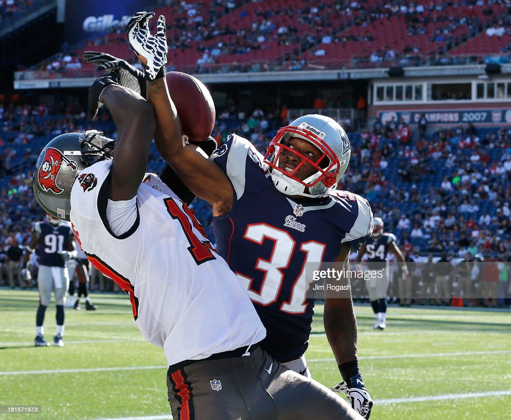 Aqib Talib #31 of the New England Patriots breaks up a pass intended for Mike Williams #19 of the Tampa Bay Buccaneers during the 4th quarter in a game at Gillette Stadium on September 22, 2013 in Foxboro, Massachusetts.