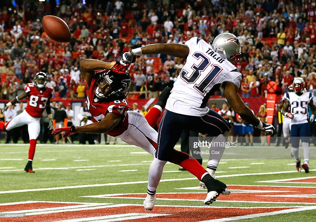 Aqib Talib #31 of the New England Patriots breaks up a touchdown reception intended for Roddy White #84 of the Atlanta Falcons in the final seconds at Georgia Dome on September 29, 2013 in Atlanta, Georgia.
