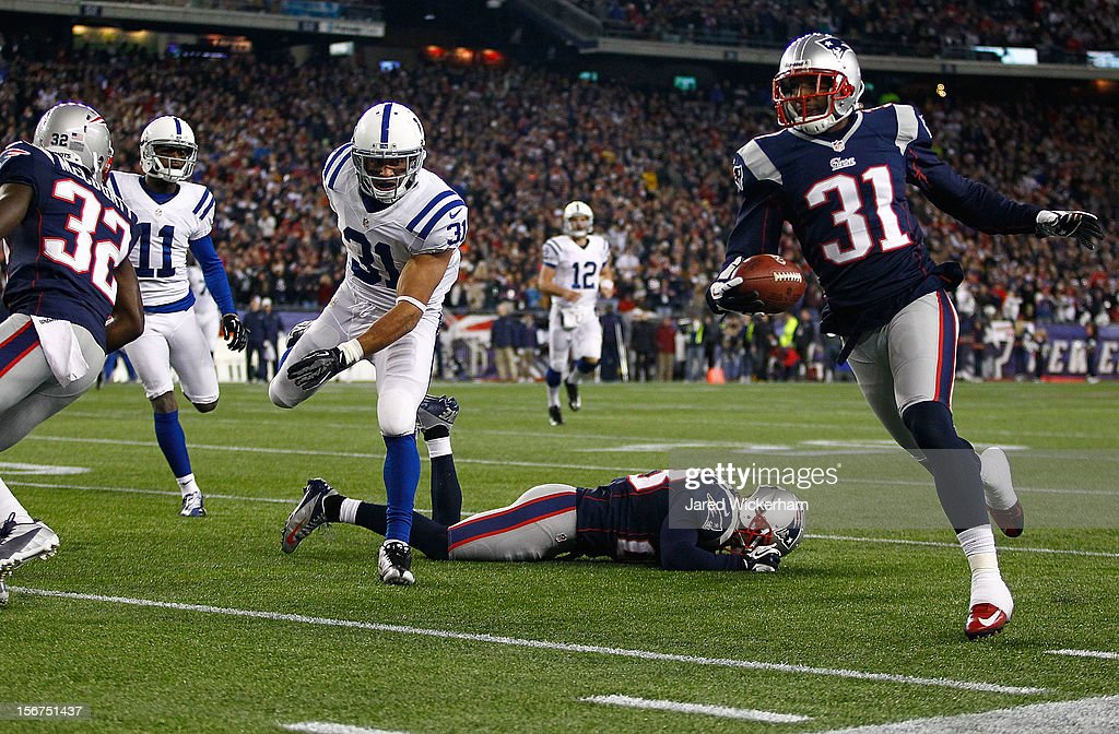 Aqib Talib #31 of the New England Patriots returns an interception for a touchdown in the first half against the Indianapolis Colts during the game on November 18, 2012 at Gillette Stadium in Foxboro, Massachusetts.