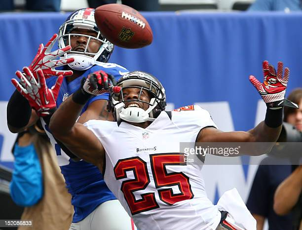 Aqib Talib of the Tampa Bay Buccaneers breaks up a pass intended for Hakeem Nicks of the New York Giants in the first half on September 16 2012 at...