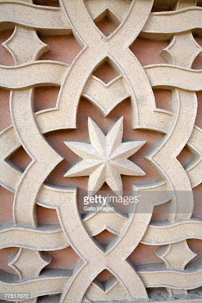 Aqsh decoration, geometric architectural detail with stars.