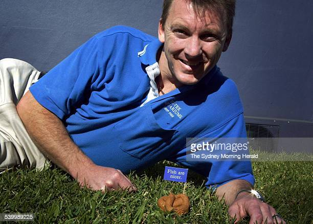 Aquarium shop owner Richard Weston with a fake dogpoo that carries a flag promoting fish as nicer pets than dogs Thousands of the fake poos will be...
