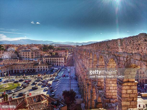 Aqueduct Of Segovia In City Against Sky On Sunny Day