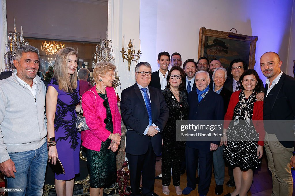 Ara Khatchadourian, Ambassador of Greece in Paris, Maria Theofili, Permanent Secretary of 'Academie Francaise' Helene Carrere d'Encausse, President of the 'Mediterranean Literature Center' Andre Bonet, Bernard Thomasson, Nana Mouskouri, Stephane Bern, Charles Aznavour, Gerard Davoust and guests attend Nana Mouskouri gives the Greek Prize 'Nikos Gatsos 2016' to Charles Aznavour at Embassy of Greece on December 19, 2016 in Paris, France.