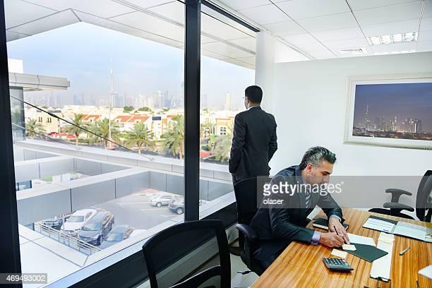 Arab business men in meeting room
