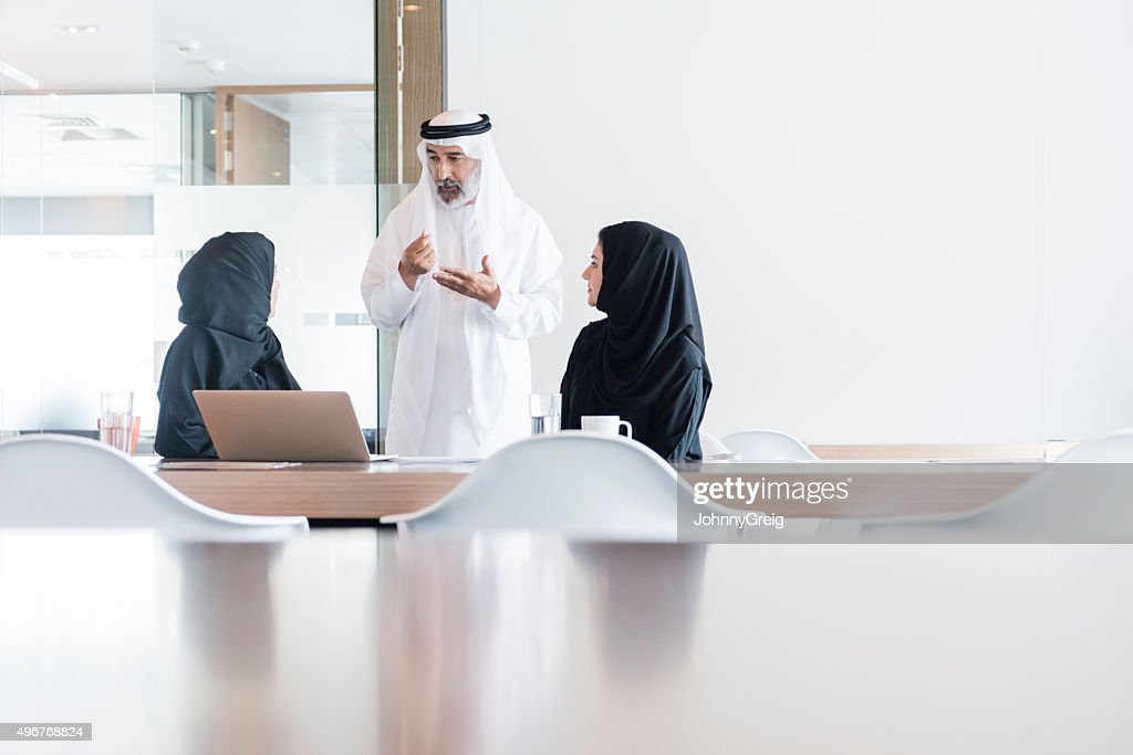 Arab businessman and women meeting in modern office, Dubai