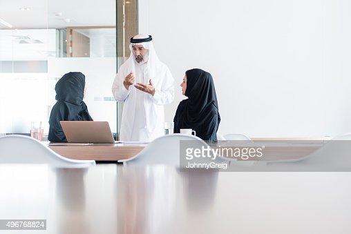 Arab businessman and women meeting in modern office, Dubai