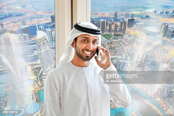 Arab businessman answering mobile phone.