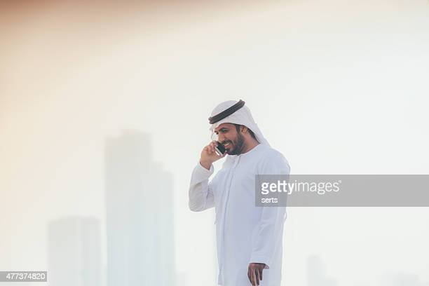 Arab businessman on the phone