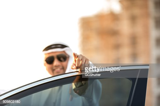 Arab Businessman Pointing Towards Camera