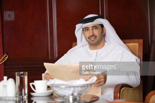 Arab Businessman Reading a Financial Newspaper