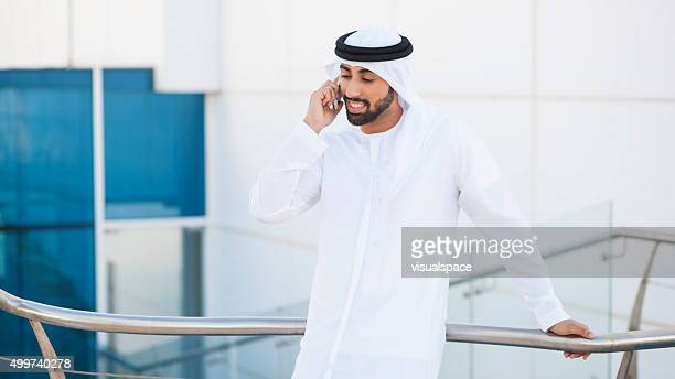 Arab Businessman Talking On Phone Outside The Office