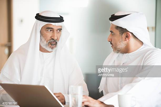 Arab businessmen in business meeting