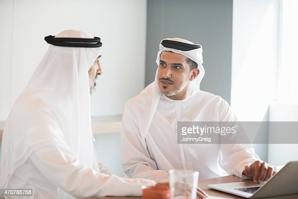 Arab businessmen in discussion