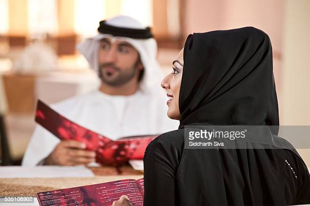 Arab couple dining at a restaurant.