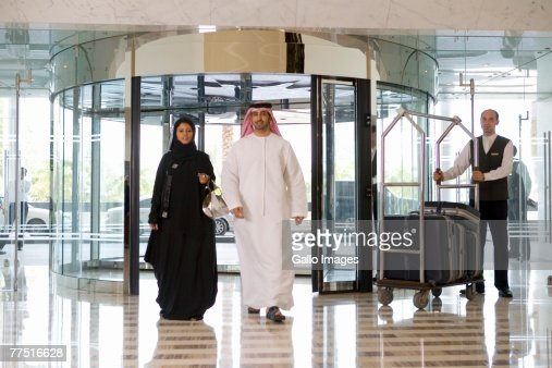 Arab Couple Entering a Hotel Lobby. Dubai, United Arab Emirates