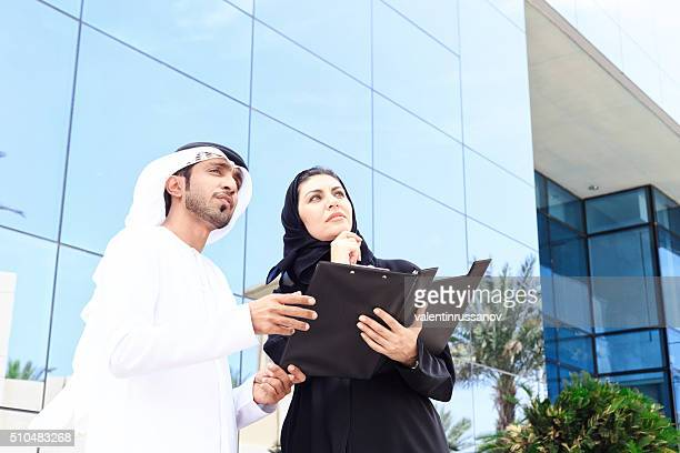Arab couple looking building for buying