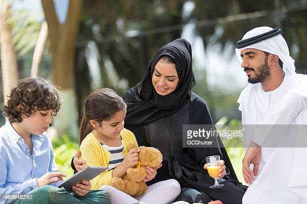 UAE Arab family enjoying a day out at the park