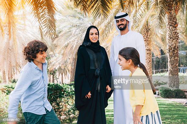 Arab family enjoying in park