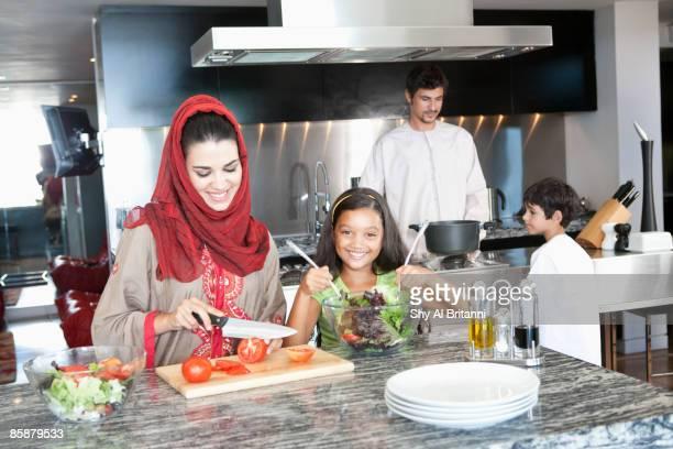 Arab family in kitchen.