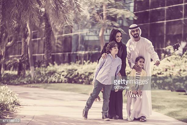 Arab family in park taking selfie