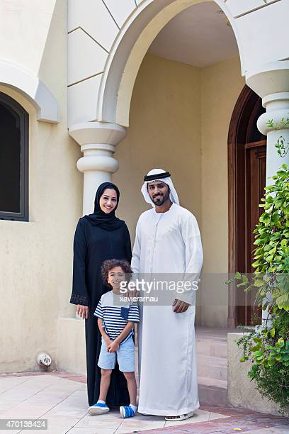 Arab family portrait in front of their home