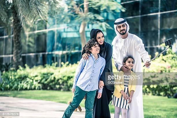 Arab Family taking selfie in a park