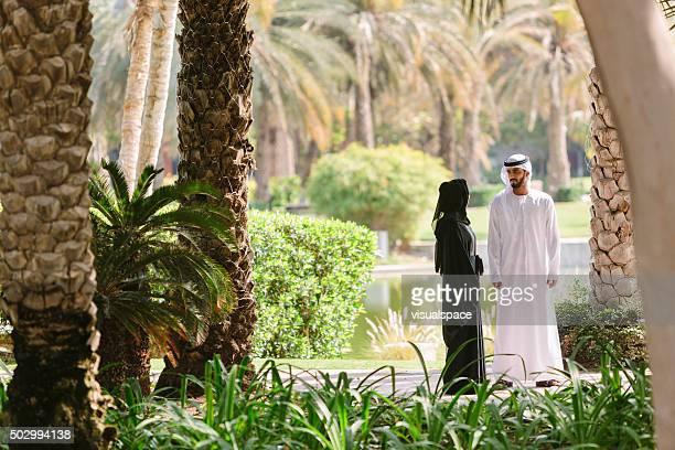 Arab Family Walking in Park