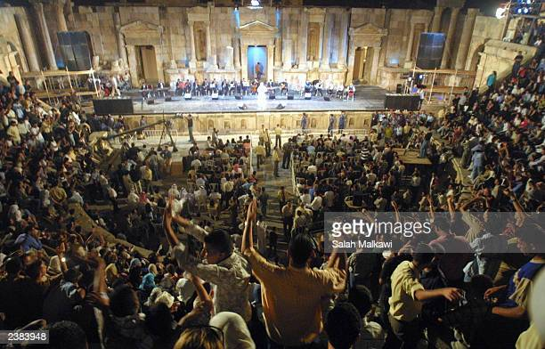 Arab fans cheer Kuwaiti singer Abdullah Rewaished performs at the southern theatre August 9 2003 in the ancient city of Jerash Jordan The cultural...