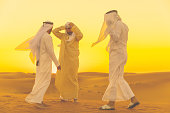 Brotherhood, Friends, Arabs, Dubai - Arab Friends standings on a sand dune and having a casual arguments