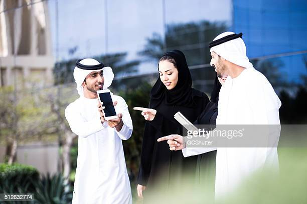 Arab Friends Having Cheerful Conversation with a Digital Tablet