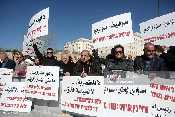Arab Israeli Knesset member Ahmad Tibi takes part in a protest with Arab Israelis against the demolition of Arab homes in the Arab Israeli town of...