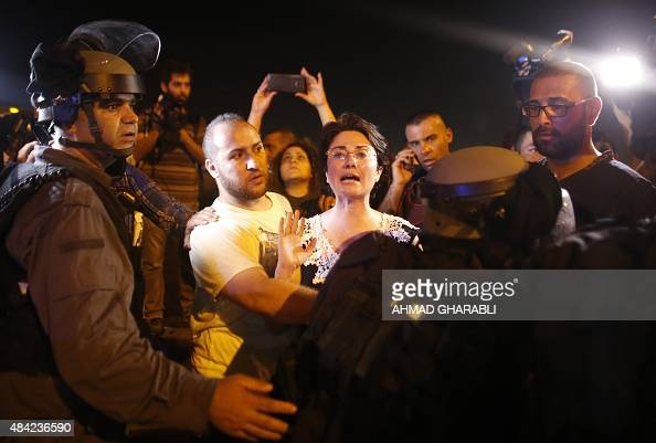 Arab Israeli MP Haneen Zoabi scuffles with Israeli security forces during a demonstration on August 16 2015 in support of Mohammed Allan a...