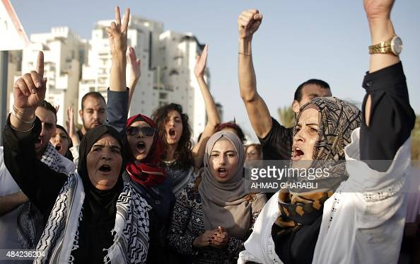 Arab Israeli protesters shout slogans during a demonstration on August 16 2015 in support of Mohammed Allan a Palestinian held by Israel without...