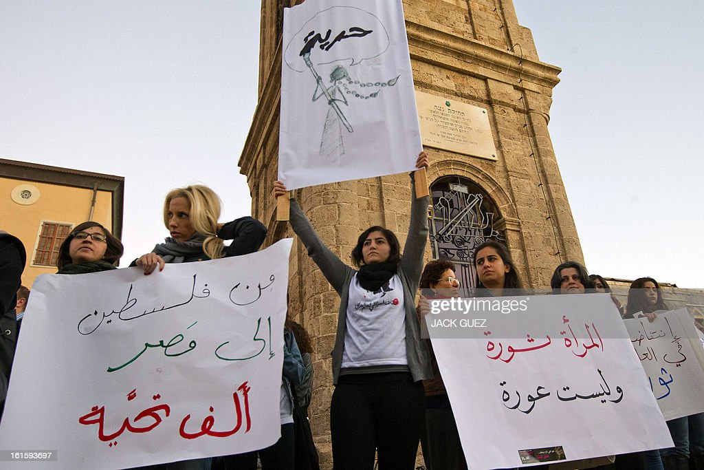 Arab Israelis gather in protest against sexual violence targeting women in Egypt, in Jaffa north of Tel Aviv, on February 12, 2013. On Cairo's streets, the sexual harassment of women, regardless of whether or not they wear an Islamic headscarf, is common in the form of obscenities, touching or groping. AFP PHOTO / JACK GUEZ