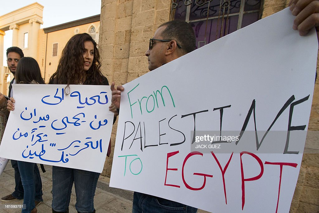 Arab Israelis gather in protest against sexual violence targeting women in Egypt, in Jaffa north of Tel Aviv, on February 12, 2013. On Cairo's streets, the sexual harassment of women, regardless of whether or not they wear an Islamic headscarf, is common in the form of obscenities, touching or groping.