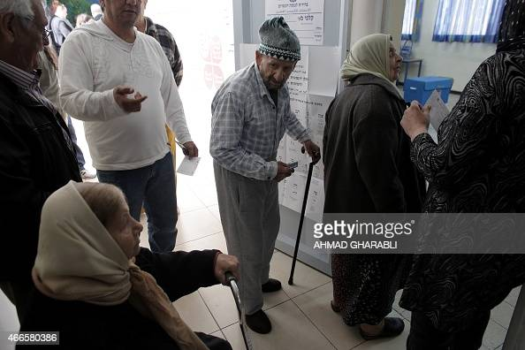 Arab Israelis queue up to cast their ballots at a polling station in the coastal city of Haifa on March 17 2015 Israelis are voting in an election...