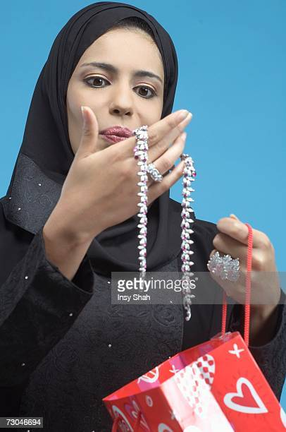 Arab Lady looking at jewelry