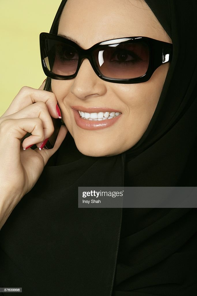 Arab lady on the phone. : Stock Photo
