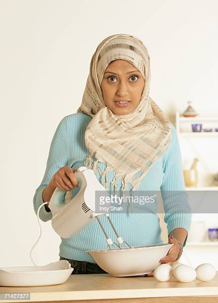 Arab Lady prepares the food