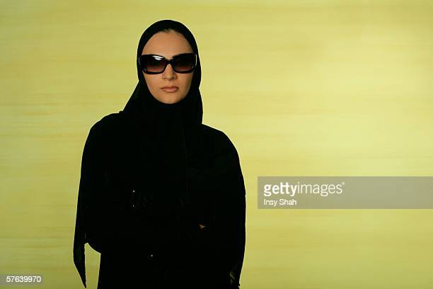 Arab lady wearing eyeglasses looking at the camera.