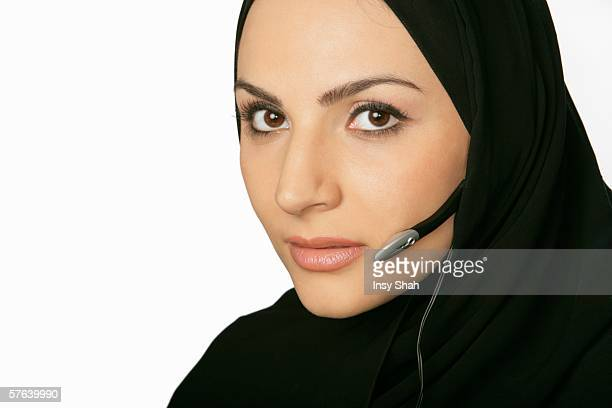 Arab lady with a headset.