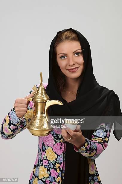 Arab lady with coffee pot and tea