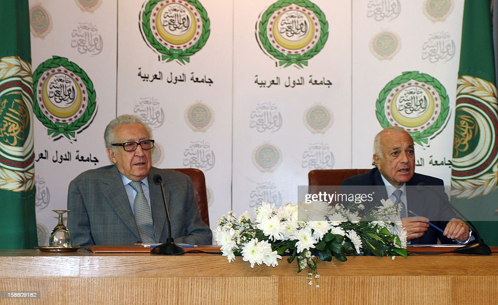 Arab League General Secretary Nabil al-Arabi (R) and UN-Arab League peace envoy Lakhdar Brahimi (L) give a press conference after their meeting in Cairo on December 30, 2012. Brahimi warned that the Syrian war was worsening 'by the day' as he announced a peace plan he believed could find support from world powers, including key Syria ally Russia. AFP PHOTO / STR